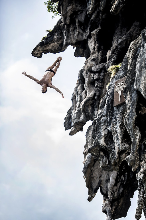 . In this handout image provided by Red Bull, Steven LoBue of the USA dives from a 25 meter rock at Viking Caves in the Andaman Sea during competition on the fifth day of the final stop of the 2013 Red Bull Cliff Diving World Series on October 24, 2013 at Phi Phi Island, Thailand. (Photo by Dean Treml/Red Bull via Getty Images)