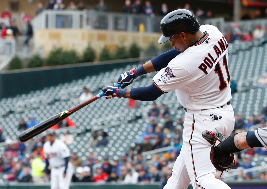 . Minnesota Twins\' Jorge Polanco follows through on a sacrifice fly off Cleveland Indians pitcher Trevor Bauer in the fourth inning of a baseball game Thursday, April 20, 2017, in Minneapolis. (AP Photo/Jim Mone)