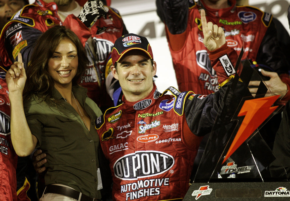 Description of . Jeff Gordon celebrates with girlfriend Ingrid Vandebosch in victory lane at Daytona International Speedway after winning the Gatorade Duel #2 qualifying auto race winner for the Daytona 500 in Daytona Beach, Fla., Thursday, Feb. 16, 2006. (AP Photo/Terry Renna)