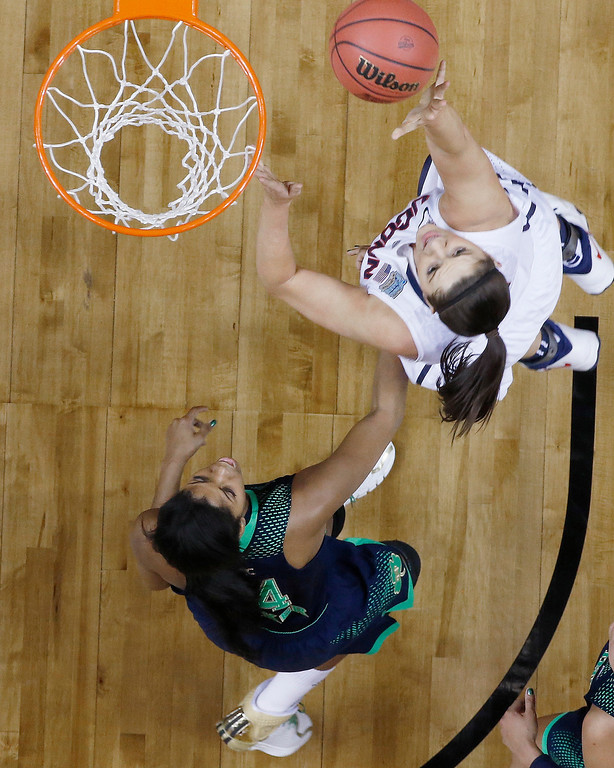 . Connecticut center Stefanie Dolson (31) shoots against Notre Dame forward Ariel Braker (44)  during the first half of the championship game in the Final Four of the NCAA women\'s college basketball tournament, Tuesday, April 8, 2014, in Nashville, Tenn. (AP Photo/John Bazemore)