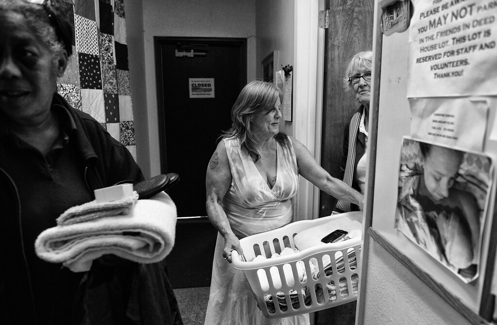 . Dorothy does laundry at the Women\'s Room where homeless woman and those at risk can shower and clean up while having lunch.