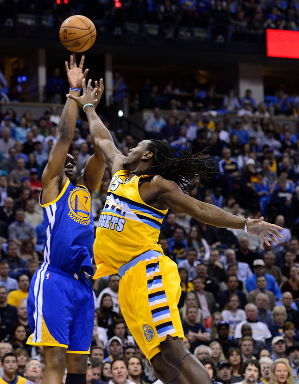 . DENVER, CO. - APRIL 23: Golden State Warriors power forward Carl Landry (7) puts up a shot while guarded by Denver Nuggets small forward Kenneth Faried (35) in the first quarter. The Denver Nuggets took on the Golden State Warriors in Game 2 of the Western Conference First Round Series at the Pepsi Center in Denver, Colo. on April 23, 2013. (Photo by AAron Ontiveroz/The Denver Post)