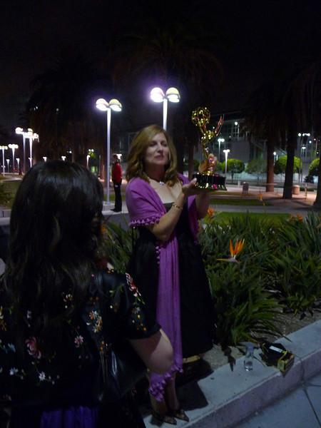 Joya holding an Emmy!