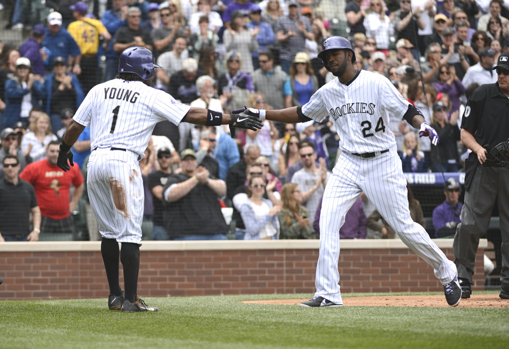 . Colorado Rockies Erick Young Jr. (1) congratulates Dexter Fowler (24) after his two run home run in the first inning against the San Diego Padres April 7, 2013 at Coors Field. (Photo By John Leyba/The Denver Post)