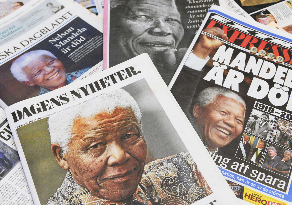 . Frontpages of Swedish newspapers depict South Africa\'s anti-apartheid icon Nelson Mandela on December 6, 2013 in Stockholm. Former South-African President Mandela, a global colossus and Nobel peace laureate died on December 5, 2013, aged 95.  JONATHAN NACKSTRAND/AFP/Getty Images