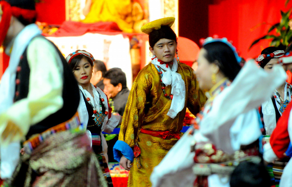 . Tenzin Paichang, middle right, dances with the Tibetan American Foundation of Minnesota dancers at Losar to entertain the Dalai Lama. (Pioneer Press: Sherri LaRose-Chiglo)