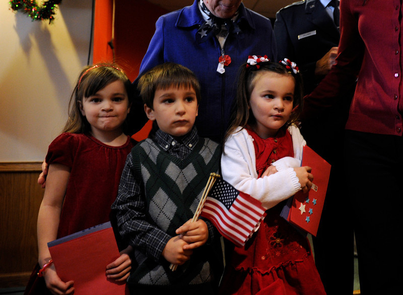 . Twin sisters Paige, left, and Ella Bundy, 4, right, and Anthony Villano, 4, brought cards and flags for the veterans. The American Legion Post 1 in Denver hosts a Remember Pearl Harbor 71st Anniversary Program on Friday, Dec. 7, 2012, honoring the survivors, their wives, and the widows. Kathryn Scott Osler, The Denver Post