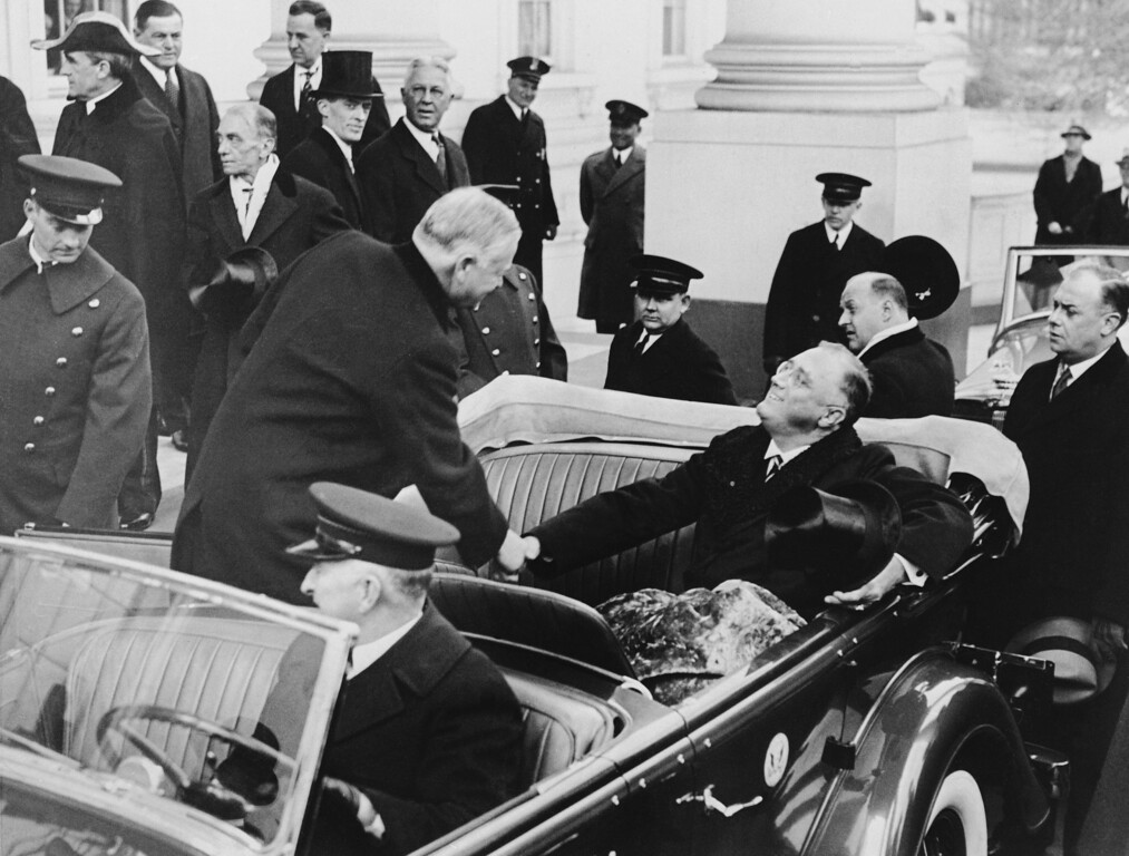 . President-elect Franklin D. Roosevelt greets current Pres. Herbert Hoover warmly as the latter steps into the Roosevelt car at the White House for the trip to the Capitol and the inaugural ceremonies in Washington, March 4, 1933.  (AP Photo)