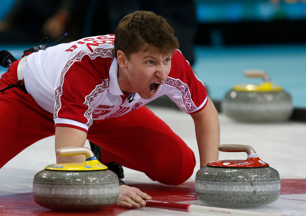. Russia\'s Andrey Drozdov shouts to his teammates to sweep harder as they approach the house in men\'s curling competition against Denmark at the 2014 Winter Olympics, Monday, Feb. 10, 2014, in Sochi, Russia. (AP Photo/Robert F. Bukaty)