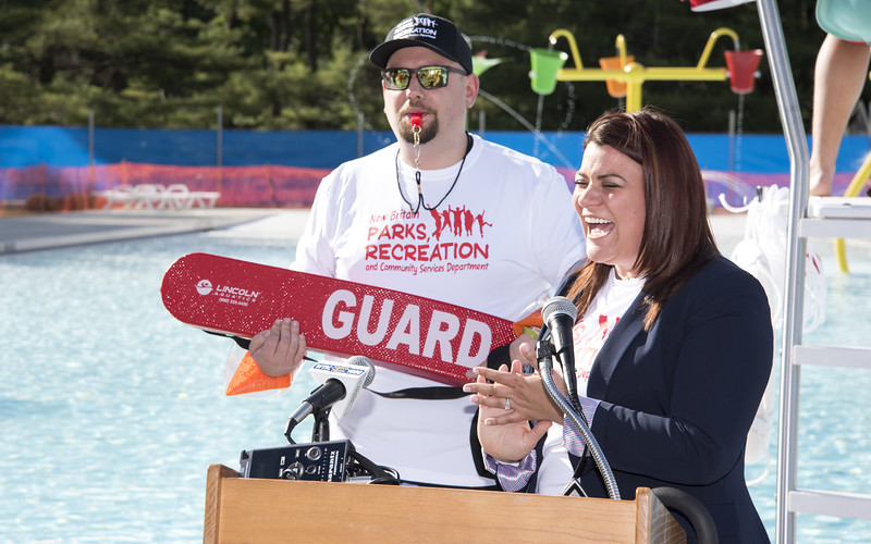 06/13/19  Wesley Bunnell   Staff  New Britain held a ribbon cutting on Friday June 14, 2019 just prior to the official opening of the new pool at A.W. Stanley Park.  Mayor Erin Stewart laughs as her Deputy Chief of Staff Justin Dorsey stands behind her dressed as a life guard.