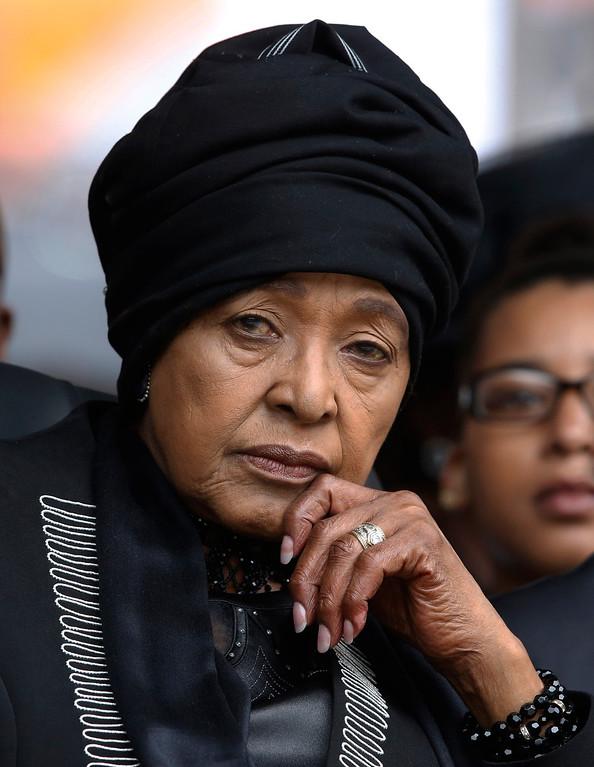 . Winnie Madikizela-Mandela, Nelson Mandela\'s former wife, listens to speakers during the memorial service for former South African president Nelson Mandela at the FNB Stadium in Soweto near Johannesburg, Tuesday, Dec. 10, 2013. (AP Photo/Matt Dunham)