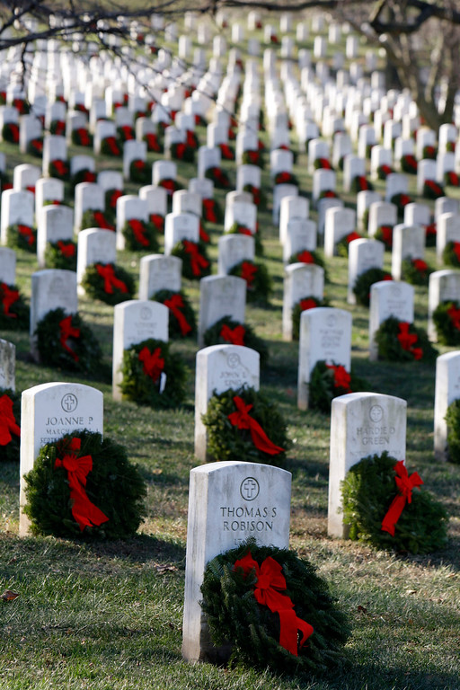 . Wreaths have been placed at graves as part of Wreaths Across America at Arlington National Cemetery in Arlington, Va., Saturday, Dec. 12, 2009. More than 16,000 wreaths were placed at graves throughout the cemetery. (AP Photo/Alex Brandon)