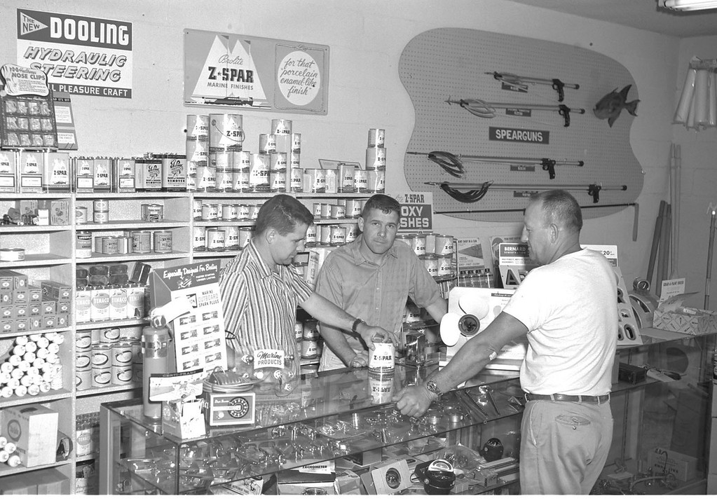 . Bill Meistrell left, Bob Meistrell (center) work with a customer at the Dive and Surf store.Body Glove Photo
