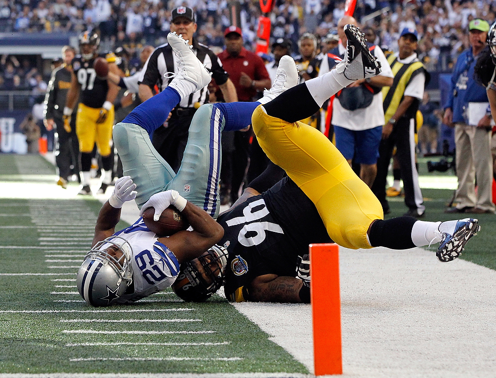 Description of . DeMarco Murray #29 of the Dallas Cowboys gets upended by Ziggy Hood #96 of the Pittsburgh Steelers short of the end zone at Cowboys Stadium on December 16, 2012 in Arlington, Texas.  (Photo by Tom Pennington/Getty Images)