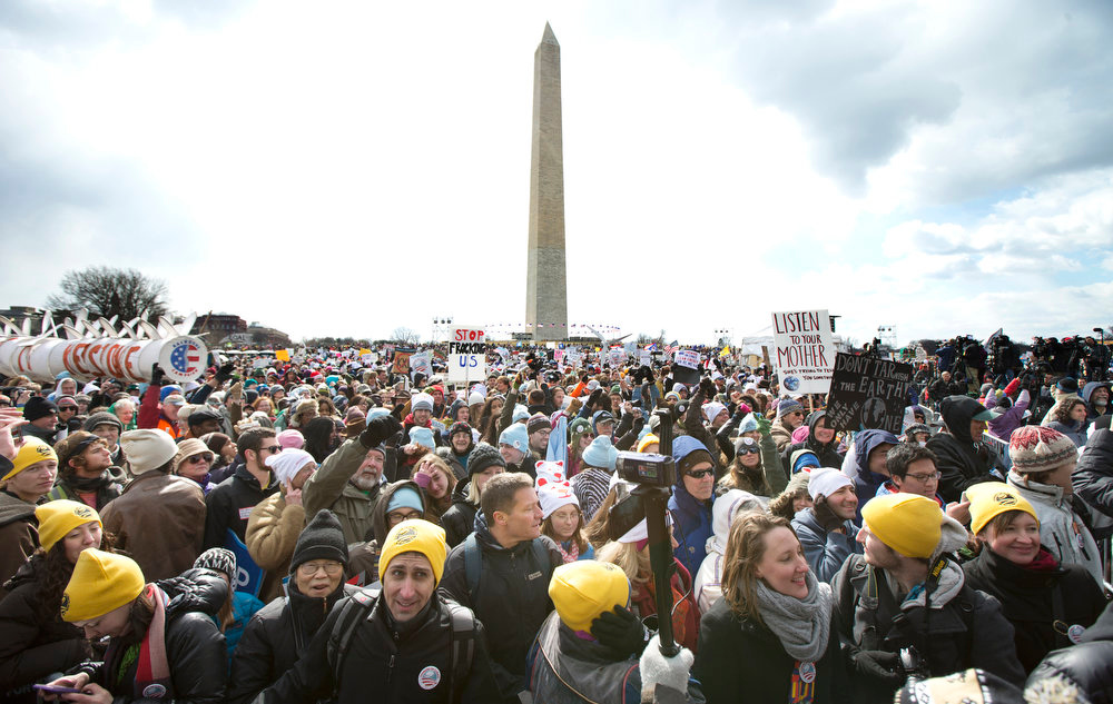 . Thousands of protestors gather at the National Mall in Washington calling on President Barack Obama to reject the Keystone XL oil pipeline from Canada, as well as act to limit carbon pollution from power plants and ìmove beyondî coal and natural gas, Sunday, Feb. 17, 2013.   (AP Photo/Manuel Balce Ceneta)