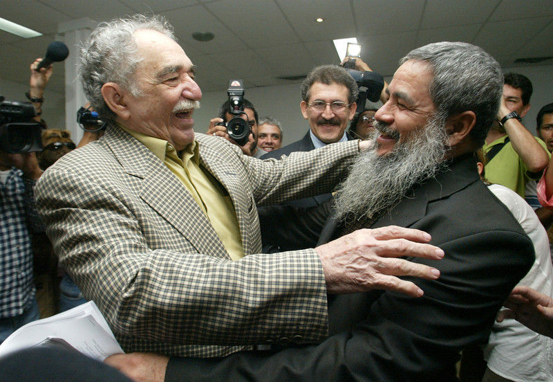 . In this Dec. 16, 2005 file photo, Colombian Nobel laureate Gabriel Garcia Marquez, left, greets National Liberation Army (ELN) spokesperson Francisco Galan before a meeting between Colombia\'s government and the ELN in Havana, Cuba. Marquez died on Thursday, April 17, 2014 at his home in Mexico City. (AP Photo/Jorge Rey, File)