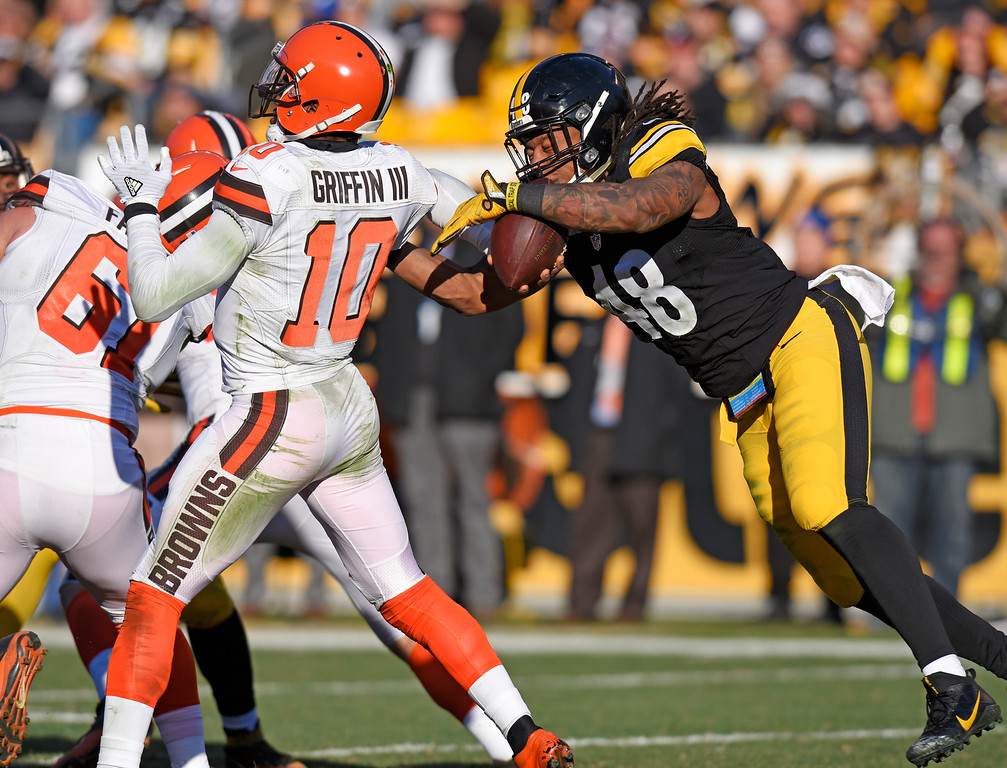 . Pittsburgh Steelers outside linebacker Bud Dupree (48) knocks the ball out of the hand of Cleveland Browns quarterback Robert Griffin III (10) during the second half of an NFL football game in Pittsburgh, Sunday, Jan. 1, 2017. (AP Photo/Don Wright)