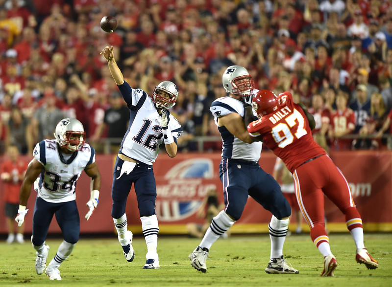 . Tom Brady #12 of the New England Patriots passes against the Kansas City Chiefs during the first half  at Arrowhead Stadium on September 29, 2014 in Kansas City, Missouri.  (Photo by Peter Aiken/Getty Images)