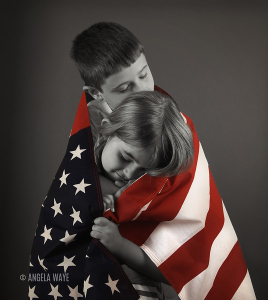 Proud American Children Hugging Flag