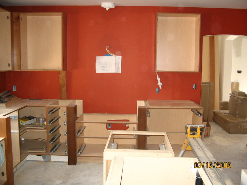 The red walls look great with the knotty alder cabinets in two tones.