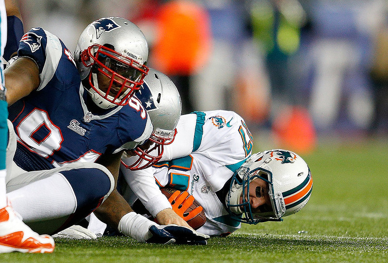 . Justin Francis #94 of the New England Patriots reacts after he sacked Ryan Tannehill #17 of the Miami Dolphins in the second half  at Gillette Stadium on December 30, 2012 in Foxboro, Massachusetts. (Photo by Jim Rogash/Getty Images)