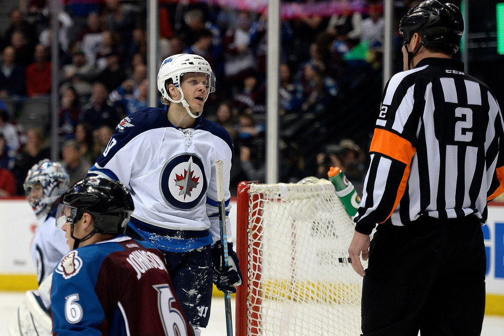 . Tobias Enstrom (39) of the Winnipeg Jets jaws with a referee after Erik Johnson (6) of the Colorado Avalanche became physical with him during the Avs\' 3-2 win. (Photo by AAron Ontiveroz/The Denver Post)