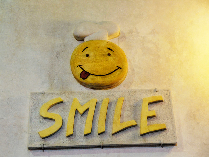 Cute SMILE sign outside pizza joint in Martina Franca...