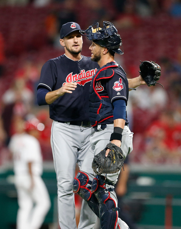 . Cleveland Indians relief pitcher Dan Otero, left, and catcher Yan Gomes celebrate the team\'s 10-3 win over the Cincinnati Reds in a baseball game, Monday, Aug. 13, 2018, in Cincinnati. (AP Photo/Gary Landers)