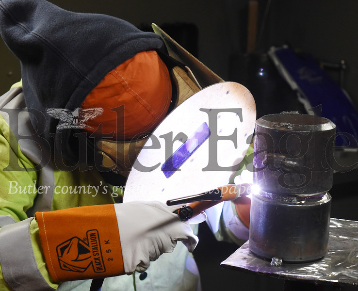 Harold Aughton/Butler Eagle: Saray Reyes of Houston, Texas practices her welding technique at the Steamfitters education shop in Harmony.