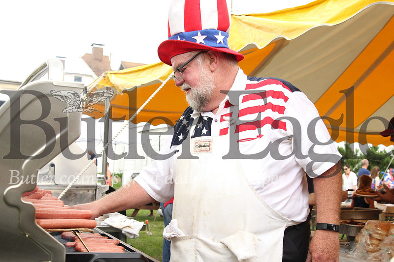 Fritz Baeher grills up some hot dogs, part of the Mars borough's free Fourth of July BBQ. Seb Foltz/Butler Eagle