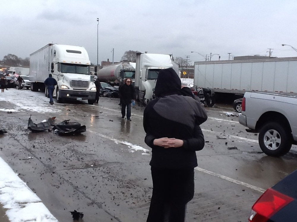 . Family members hug at the scene of a multi-vehicle accident on southbound I-75 in Detroit on Thursday, Jan. 31, 2013. Snow squalls and slippery roads led to deadly accidents on a Detroit freeway Thursday, leaving at least two dead and about 20 injured on a mile-long stretch of roadway involving more than two dozen vehicles including tractor-trailers. (AP Photo/Detroit Free Press, Mandi Wright)