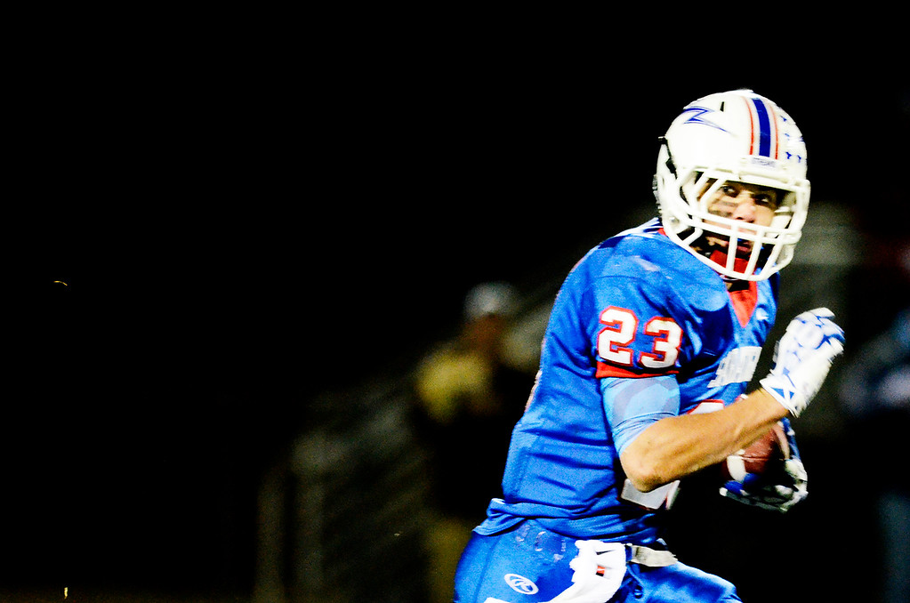 . Erica Miller - The Saratogian @togianphotog      Saratoga\'s Jordan Wilcox runs down the field during their playoff football game against LaSalle on Friday evening under the lights in Saratoga. SAR-l-SarFootball9