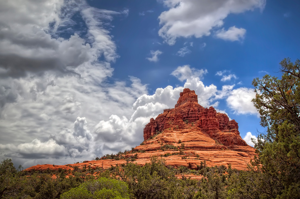 "<h2>High Noon at Bell Rock</h2> I'd been in lovely Sedona for a gathering. It was June and it rained pretty much the whole time. Of course, the sun came out as I was leaving for the airport to come home. Bell Rock at noon. Who shoots at noon, I thought? But it was my only chance, so I pulled over with only a few moments to find that shot that would speak of my experience there. There was no romantic, mysterious early morning/late afternoon glow... just the stark overheadness of high noon to work with. This was the result.   Proving to myself once again, that sometimes we just have too many expectations about ""special""... when it might be just sitting there staring at us under the high noon sun."