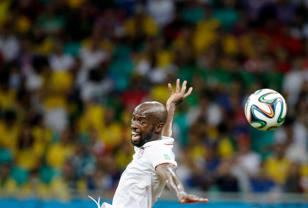 . United States\' DaMarcus Beasley goes for the ball during the World Cup round of 16 soccer match between Belgium and the USA at the Arena Fonte Nova in Salvador, Brazil, Tuesday, July 1, 2014. (AP Photo/Felipe Dana)