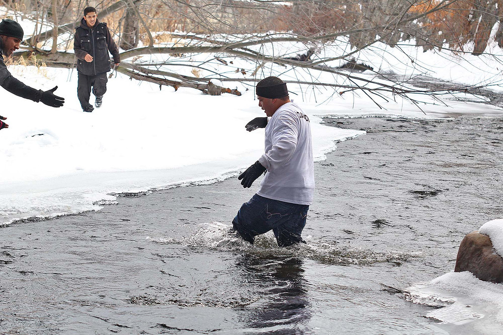 . Jose Oliver the father of the missing Fitchburg boy Jeremiah Oliver, 5, got a little wet in the Nashua Riveras her crossed it during the searched for Jeremiah on Saturday in Fitchburg. SENTINEL & ENTERPRISE/JOHN LOVE