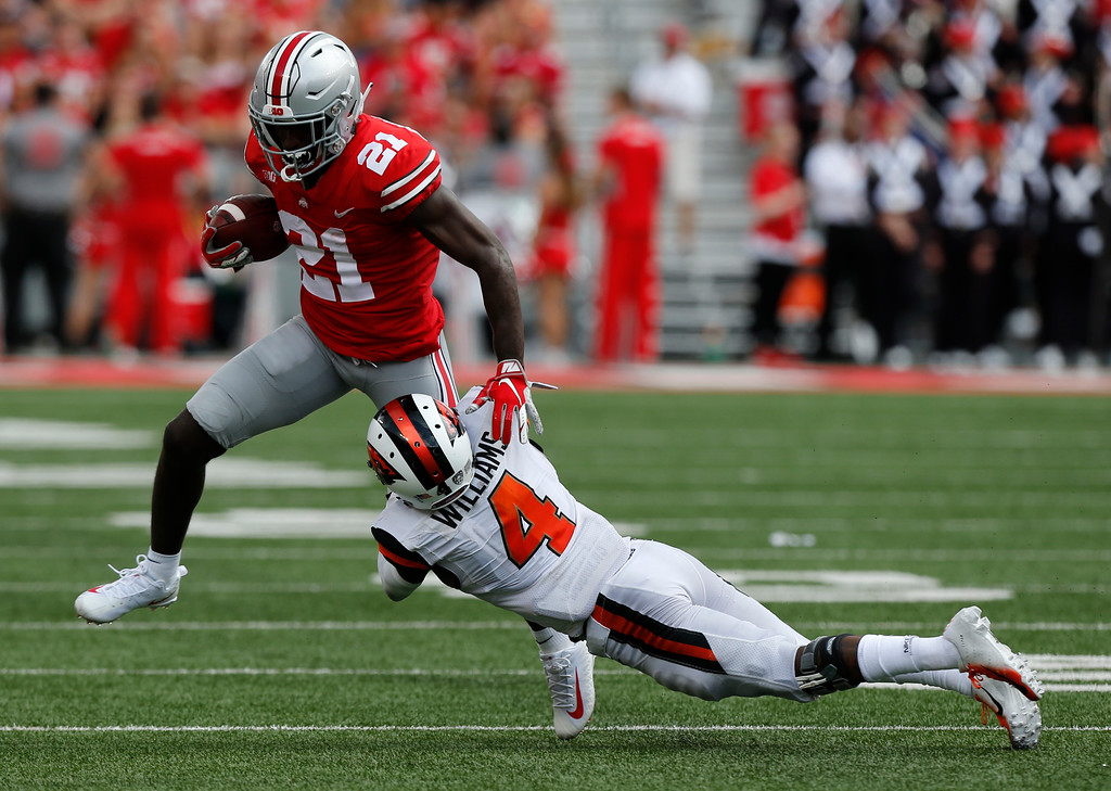 . Ohio State receiver Parris Campbell, left, escapes the grasp of Oregon State defensive back Dwayne Williams during the second half of an NCAA college football game Saturday, Sept. 1, 2018, in Columbus, Ohio. Ohio State beat Oregon State 77-31. (AP Photo/Jay LaPrete)
