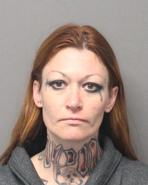 . Jessica Garrett (32) of Colorado arrested on numerous firearms charges. Central Falls Police Department