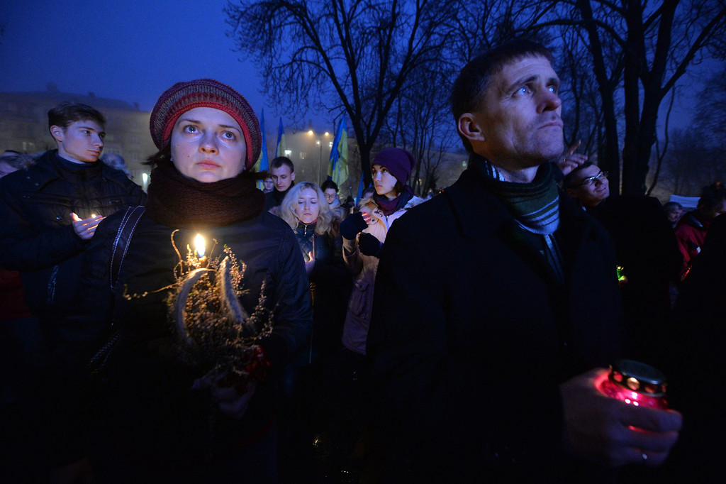 . Ukrainians hold candles in memory of the victims of the Holodomor famine during a ceremony at the Holodomor memorial in Kiev on November 23, 2013.  AFP PHOTO/ SERGEI  SUPINSKY/AFP/Getty Images