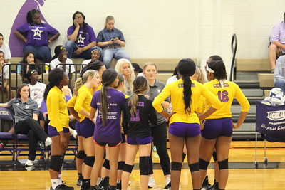 Scenes from Center Lady Riders volleyball action vs. Central Heights