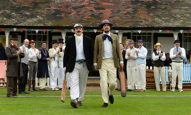 . Authors Charlie Campbell (R) and Sam Carter walk out to bat before a Victorian Cricket match to commemorate the 150th anniversary of Wisden Cricketers\' Almanack  at Vincent Square in London May 29, 2013. REUTERS/Philip Brown