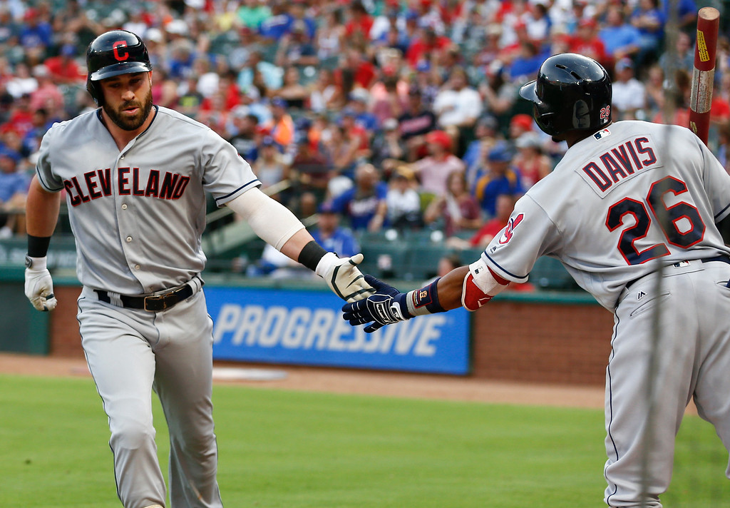 . Cleveland Indians\' Jason Kipnis, left, celebrates his two-run home run with Rajai Davis (26) against the Texas Rangers during the second inning of a baseball game, Friday, July 20, 2018, in Arlington, Texas. (AP Photo/Jim Cowsert)