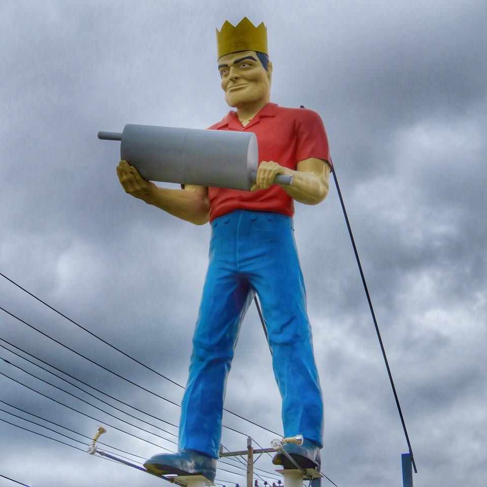 newport news virginia muffler man holding an actual muffler