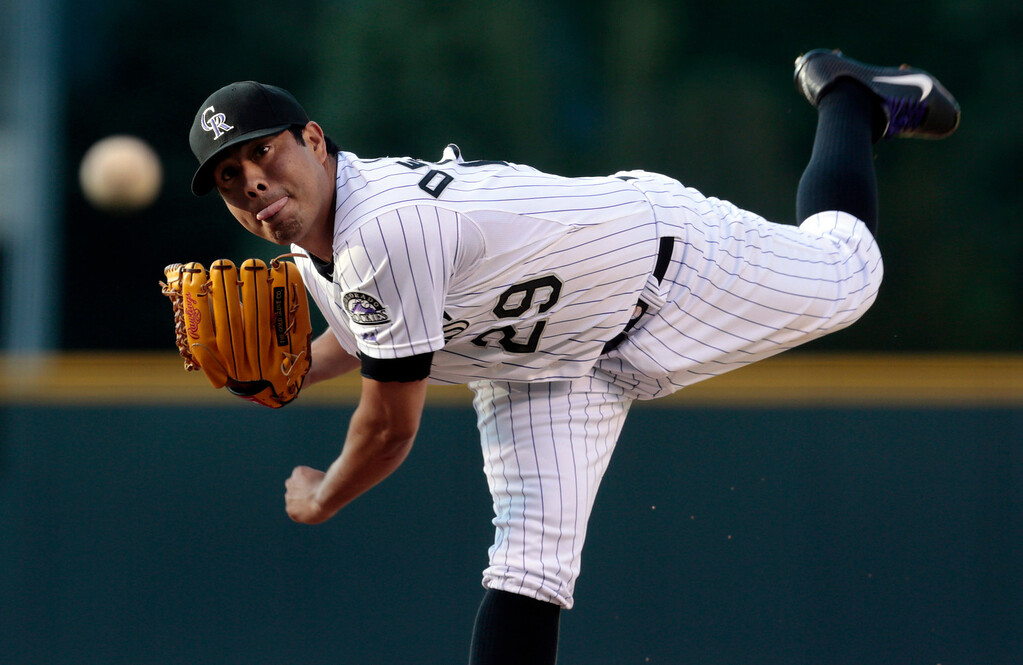 . Colorado Rockies starting pitcher Jorge De La Rosa delivers against the Chicago Cubs in the first inning of a baseball game in Denver, Friday, July 19, 2013. (AP Photo/Joe Mahoney)
