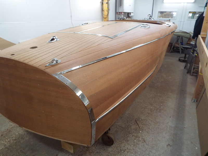 Rear starboard view of the new rub rail, transom guard and spray rail trim fit.