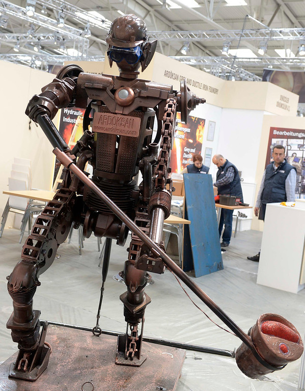 . A robot figure is seen during preparations at the Hanover industrial fair in Hanover, April 7, 2013. The Hanover fair opens its doors to the public on April 8 and will end on April 12. REUTERS/Fabian Bimmer