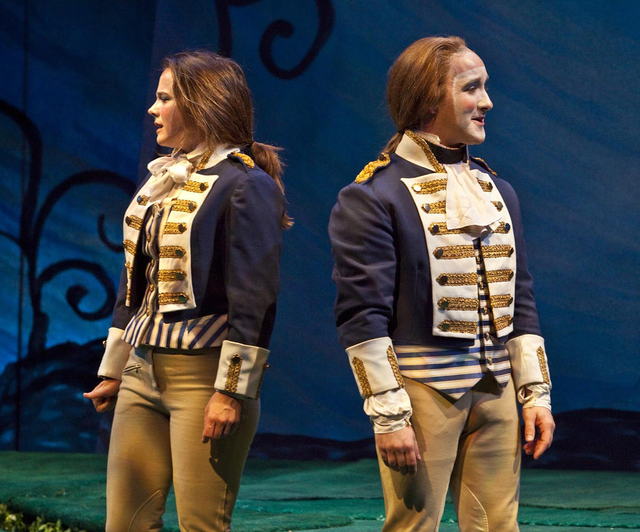 ". Viola (Lenne Klingaman, left) disguised as ""Cesario,\"" unexpectedly encounters her twin brother Sebastian (Jesse James Thomas, right) in Shakespeare Santa Cruzís 2012 production of \""Twelfth Night.\"" (Courtesy: Shakespeare Santa Cruz)"