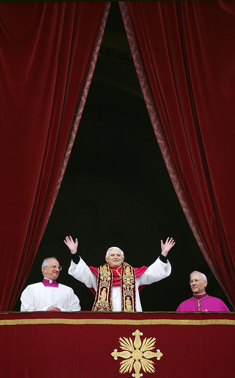 . Pope Benedict XVI, Cardinal Joseph Ratzinger (C) of Germany, waves from a balcony of St. Peter\'s Basilica in the Vatican after being elected by the conclave of cardinals April 19, 2005 in Vatican City.  The 265th Pope will lead the world\'s 1 billion Catholics. (Photo by Mario Tama/Getty Images)