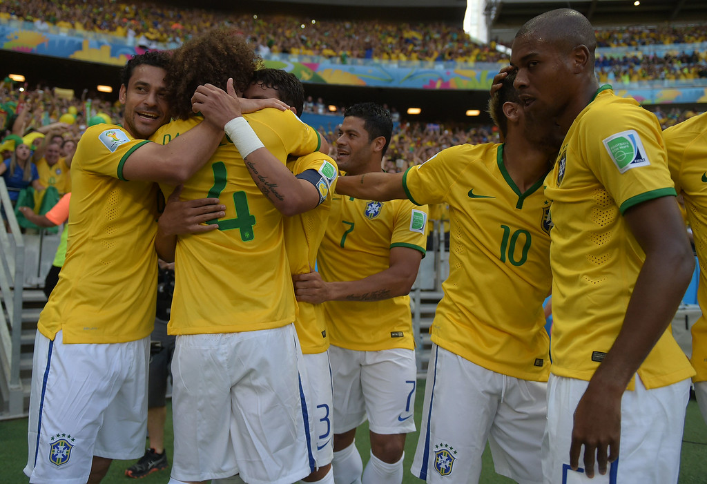 . Brazil\'s defender and captain Thiago Silva (3dL) is congratulated by teammates after scoring during the quarter-final football match between Brazil and Colombia at the Castelao Stadium in Fortaleza during the 2014 FIFA World Cup on July 4, 2014. EITAN ABRAMOVICH/AFP/Getty Images