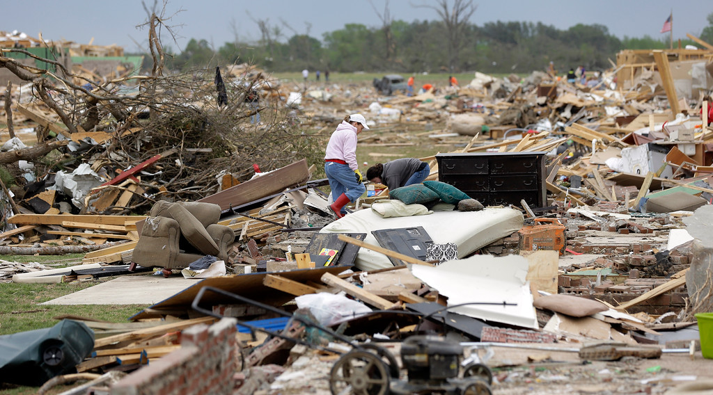 . Volunteers continue to salvage items for residents who lost their homes to Sunday\'s tornado, Tuesday, April 29, 2014, in Vilonia, Ark.  (AP Photo/Eric Gay)