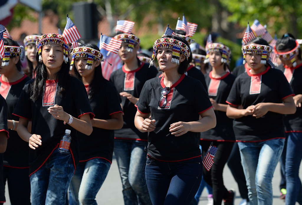 . Members of the Vox Nativa Chior Taiwan perform during  the Fourth of July parade in Fremont, Calif., on Thursday, July 4, 2013. The parade featured more than 70 entries. (Dan Honda/Bay Area News Group)
